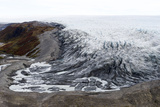 A River Skirts a Pile of Rock  Sediment and Silt Debris Deposited by the Leading Edge of a Glacier