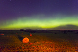 The Aurora Borealis or Northern Lights over Agricultural Land