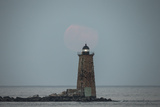 Whaleback Lighthouse Stands Out in the Night as the Supermoon Fades into the Evening