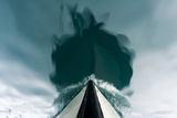 The Bow of a Boat Passing over the Still Waters of an Arctic Fjord