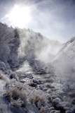 Steam Rising over the Snowy Banks of a Hot Spring