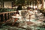 Three Ballerinas in White Tutus Dancing in Bryant Park at Night