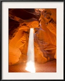 Sunlight Streams Through Cracks in a Slot Canyon
