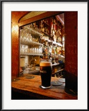 A Pint of Dark Beer Sits in a Pub Service Window