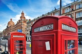 Typical Red Telephone Boxes on Brompton Road with Harrods Building on the Background