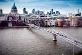 Millenium Bridge over the Thames and St Paul Cathedral on the Background  London