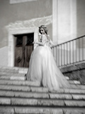 Young Adult Female in Long Wedding Dress Standing on Steps