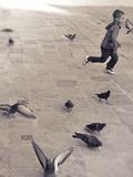 Child Running across Stones  Venice  Italy