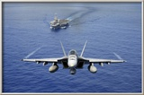 An F-A-18E Super Hornet Flying Above USS John C Stennis