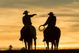 Cowboys and Horses in Silhouette at Dawn on Ranch  British Colombia  Canada