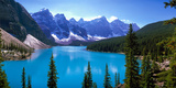Scenic View of Moraine Lake by Mountains in Banff National Park, Calgary, Alberta, Canada Papier Photo par Panoramic Images