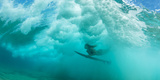 Female Surfer Pushes under a Wave While Surfing  Clansthal  South Africa