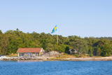 Sweden  Stockholm - House on Island in Archipelago with Swedish Flag on Pole