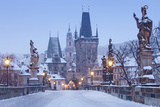 Prague - Charles Bridge Tower Nad St Nicolas Church on Winter Morning