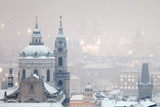 Prague - St Nicholas Church and Spires of the Old Town During Snowfall