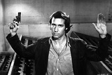 Chevy Chase in Black Suit With Pistol
