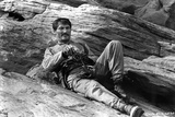 Jack Palance Lying on Rock With Gun
