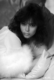 Rachel Ward Leaning on Couch with Fur Scarf Black and White Portrait
