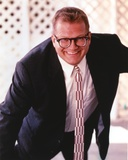 Drew Carey smiling in Coat Portrait