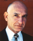 Ben Kingsley Close Up Portrait with Plain Smile in Black Suit and Printed Ties