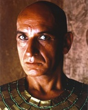 Ben Kingsley Close Up Portrait Looking Serious and Bald in Gold Egyptian Outfit