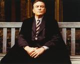 Albert Finney sitting in Tuxedo