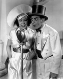 Eddie Cantor standing in White Suit With Dog