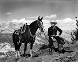 Gene Autry Seated with a Horse