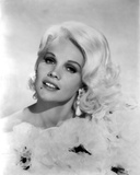 Carroll Baker wearing a Ruffled Dress with Earrings