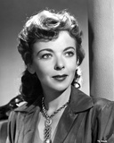 Ida Lupino wearing a Necklace and a Silk Blouse