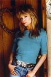 Rebecca Demornay Finger in Pocket Pose wearing Blue Sweater