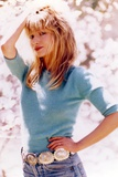 Rebecca Demornay Hand on Hips Pose wearing Blue Sweater