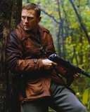 Daniel Craig Holding Firearms in Brown Leather Coat
