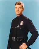 Adam-12 Posed in Police Uniform with Light Blue Background