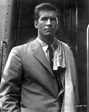 Anthony Perkins standing in White Suit