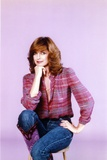 Linda Gray sitting in Pink Background