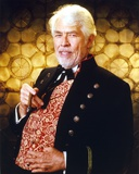 James Coburn Portrait in Black Velvet Suit and Brown Shiny Silk Shirt with Black Bow Tie with Right