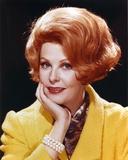 Portrait of Arlene Dahl in Yellow Coat with Gold Bracelet