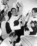 Guy Lombardo in White Suit With People