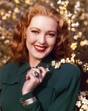 Linda Darnell in Black Coat with Flowers Portrait