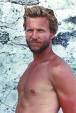 Jeff Bridges posed in Portrait Posed Topless Facing to the Right in White Background