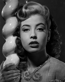 Gloria DeHaven in A Portrait Leaning On A Pole in Black and White