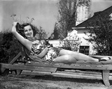 Constance Moore on a Printed Midriff Lying on a Sunbathing Bed