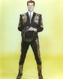 Hugh O'Brien in Embroidered Suit on Yellow Background