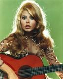 Charo Playing Guitar in Gray Background