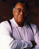 James Jones Close Up Portrait in White Long Sleeve Shirt and Round Eyeglasses with Arm Crossed