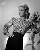 Gloria DeHaven posed in Checkered Dress in Black and White