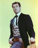 Hugh O'Brien wearing a Suit on Yellow Background