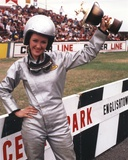 Bonnie Bedelia Posed with Her Trophy in Car Racing Outfit