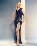 May Britt standing in Black Dress